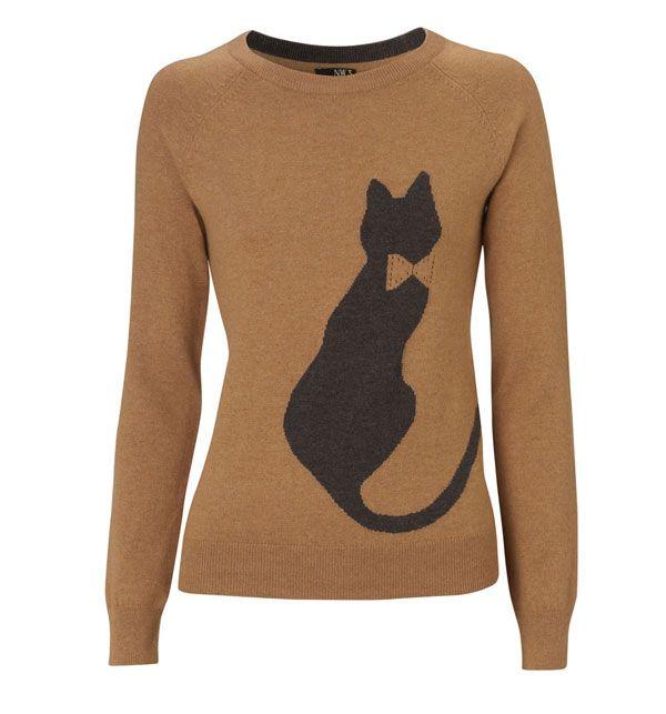 Chat chic: vêtements sur le thème de Kitty sans gilet de tapisserie en vue